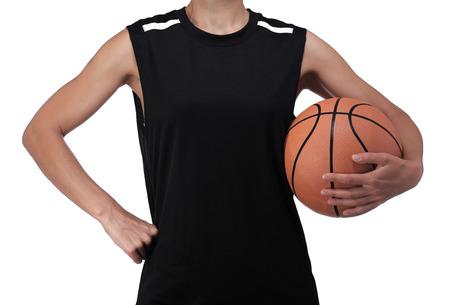 balon baloncesto: fotografía de un jugador de baloncesto sosteniendo una pelota