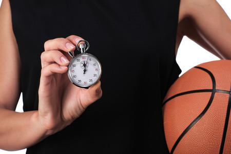 balon baloncesto: fotograf�a de un jugador de baloncesto que muestra un cron�metro
