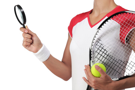rigor: photography of a female tennis player holding a magnifying glass