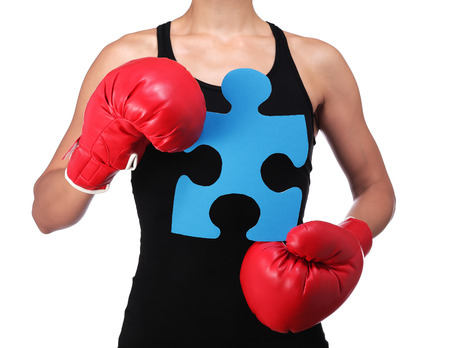 photograph of a bust of a woman boxer holding a puzzle piece