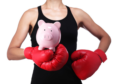 contemporary woman: photograph of a bust of a woman boxer with a piggy bank