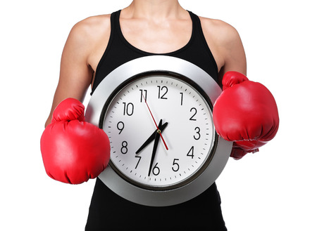 photograph of a bust of a woman boxer with a clock