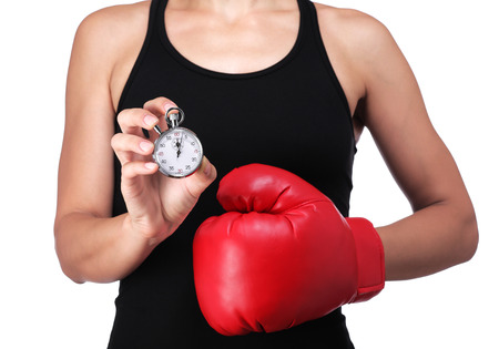 photograph of a bust of a woman boxer with a stopwatch Stock Photo
