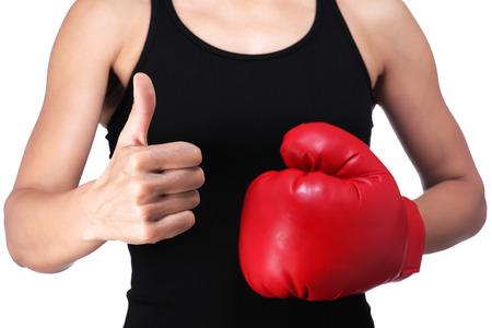 photograph of a woman boxer doing okay sign