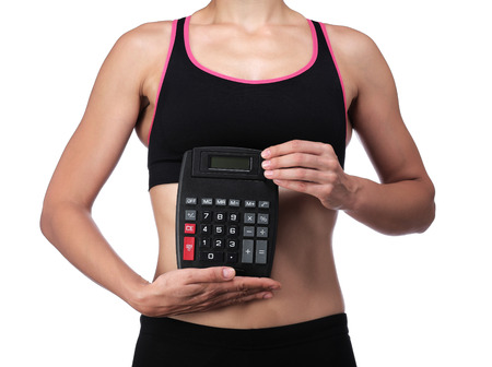 photography of a sports coach holding a calculator Stock Photo