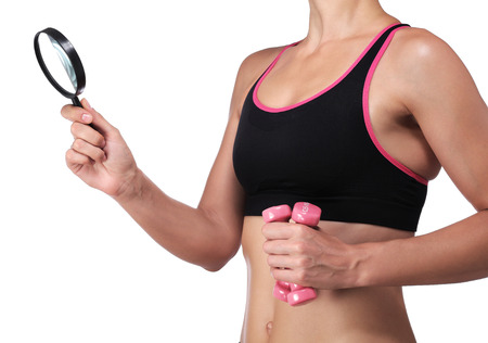 photography of a woman in sportswear holding a magnifying glass