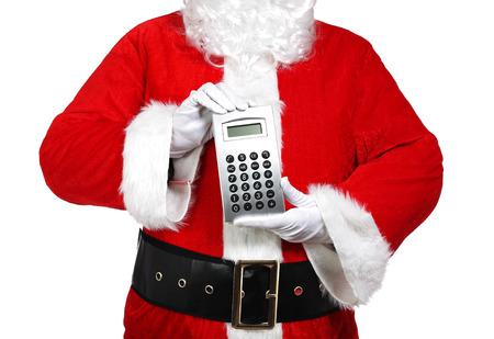 photography of Santa Claus holding a calculator Stock Photo