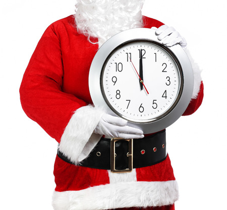 photography of Santa Claus holding a clock