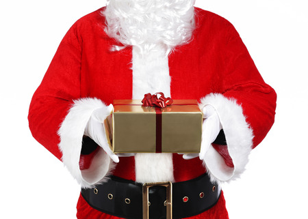 photography of Santa Claus holding a gift