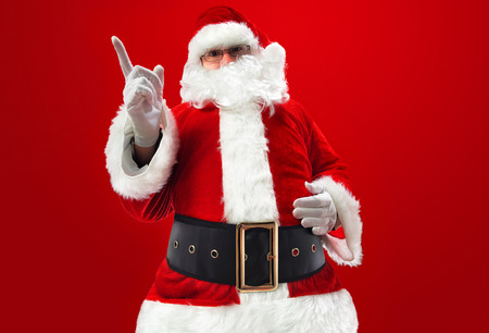 photography of Santa Claus on red background Stock Photo