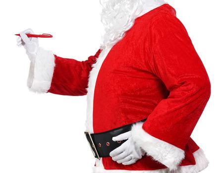 Photography of Santa Claus holding a pen Stock Photo