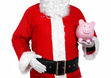 photography of Santa Claus holding a piggy bank Stock Photo