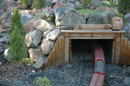 going in: toy train going in to tunnel Stock Photo