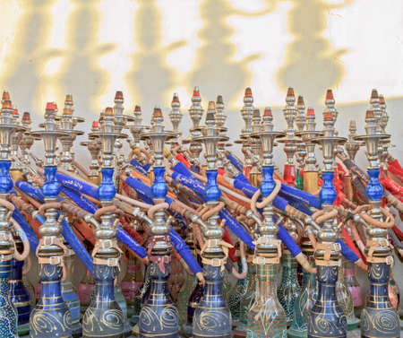 Row of colourful red and blue sheesha pipes at the souk in Doha photo