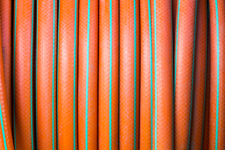 plastic conduit: garden hose background texture Stock Photo