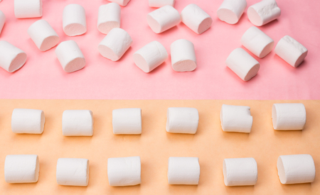Sweet marshmallows on pastel yellow and pink background. Stok Fotoğraf