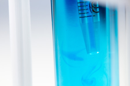 Pipette in test tube with blue liquid water in laboratory. Stok Fotoğraf