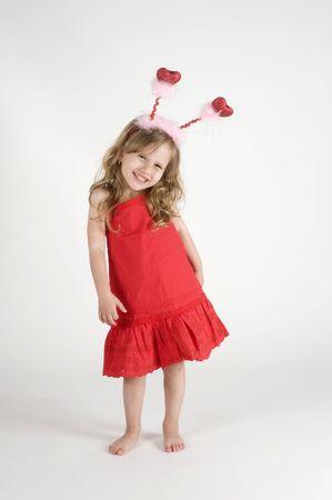 baby girls smiley face: Little girl posing  with Heart-Shape antennas
