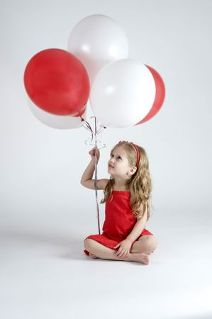 baby girls smiley face: Girl holding Balloons and looking at them