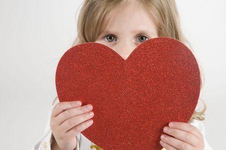 Little Girl holding a heart shape Stock Photo - 4349174
