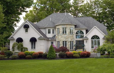 One of he most beautiful house I have seen. Reminds me of a castle with the stone round front architecture and the landscaping is immaculate. Just waiting for a princess to walk out.