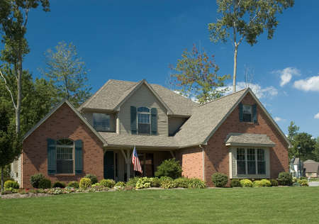 Brick home with an American Flag. Stock Photo - 237070