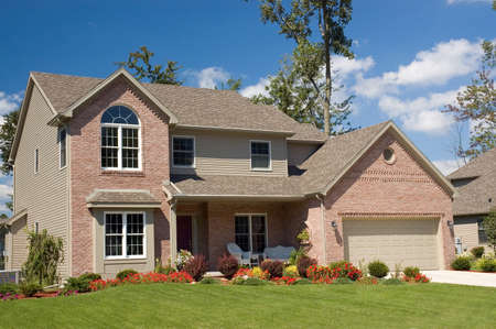 Gorgeous brick home with lots of nice masonry details. Stock Photo