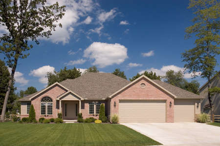 Brown brick ranch with a three car garage. This is one of many in my home series. Stock Photo