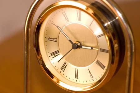 Close-up of a brass clock. Archivio Fotografico
