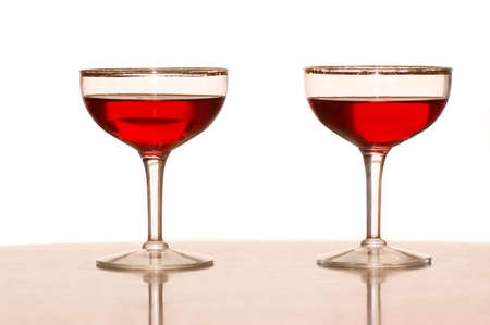 Two wine glasses with red wine against a white background. Stock Photo