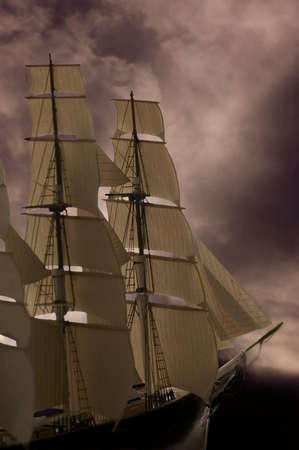 A tall ship sailing into stormy seas. Good concept photo for business.