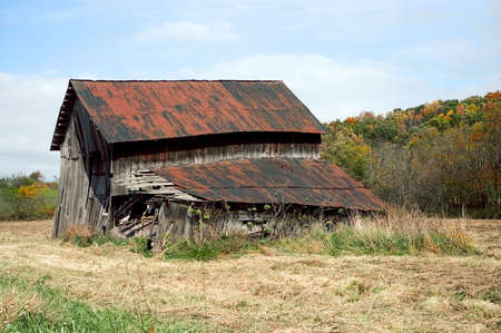 tin: Old barn that is falling apart. Part of the rural landscape of Ohio.