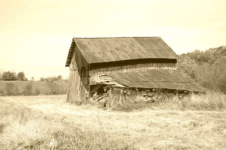 Old barn with a vintage look. Warm yellow filter applied to give it an old time vintage feel.