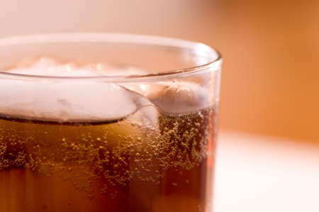 Close-up of cola on ice.