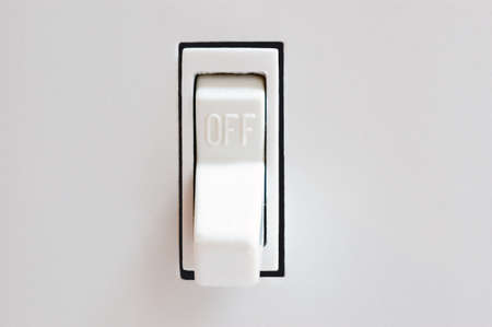 flip: A light switch in the off position. Stock Photo