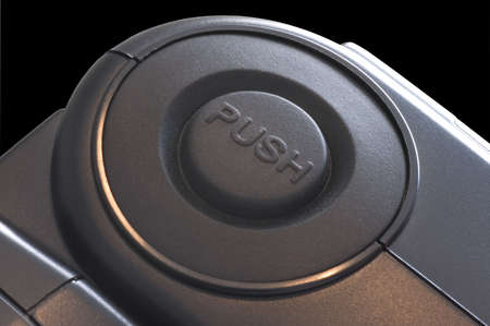 A macro of a button that says push. Good concept photo.
