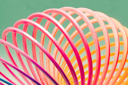 slinky: Colorful close-up of a slinky type toy. Stock Photo