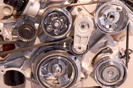 sprockets: Close-up look at a modern automobile engines belts and pulleys. Stock Photo