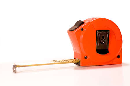 Orange colored tape measure on a white background.