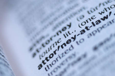 intentional: Extreme macro or close up of the words ATTORNEY AT LAW Very shallow depth of field is intentional and shows only the words attorney at law in focus. Stock Photo