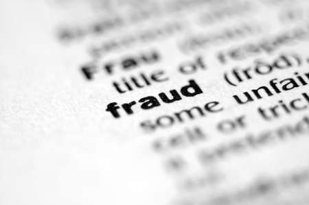 Extreme macro or close up of the word FRAUD. Very shallow depth of field is intentional and shows only the word fraud in focus.