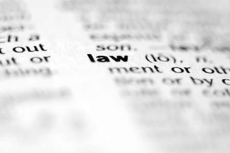 Extreme macro or close up of the word LAW. Very shallow depth of field is intentional and shows only the word LAW in focus. Stock Photo