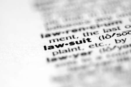 lawsuit: Extreme macro or close up of the word LAW-SUIT. Very shallow depth of field is intentional and shows only the word LAW-SUIT in focus.