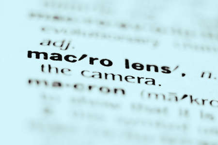 Extreme macro or close up of the words MACRO LENS. Very shallow depth of field is intentional and shows only the words macro lens in focus.