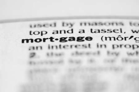 Extreme macro or close up of the word MORTGAGE. Very shallow depth of field is intentional and shows only the word mortgage in focus.