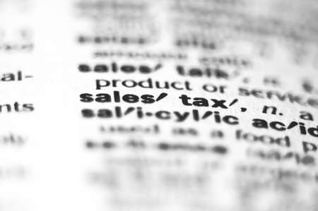 Extreme macro or close up of the word Sales Tax. Very shallow depth of field is intentional and shows only the word sales tax in focus.