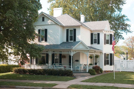 A American home in a small town in Ohio. This home has some nice ornate molding details on the porch. Stock Photo