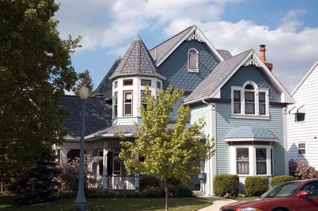 Beautiful example of a Queen Anne Victorian style home. Great detail work in the roof line and also elaborate molding details. This home is located in historic Lancaster Ohio. Stock Photo - 399851