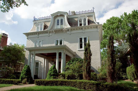 architectural style: Italianate style or Second Empire architectural style house. Its distinctive Mansard roof sets it off. This home is located in historic Lancaster Ohio.