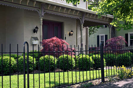 Wrought iron fencing and ornate Victorian roof brackets highlight this elegant front entrance to this home. This house is located in historic Lancaster Ohio. Banco de Imagens